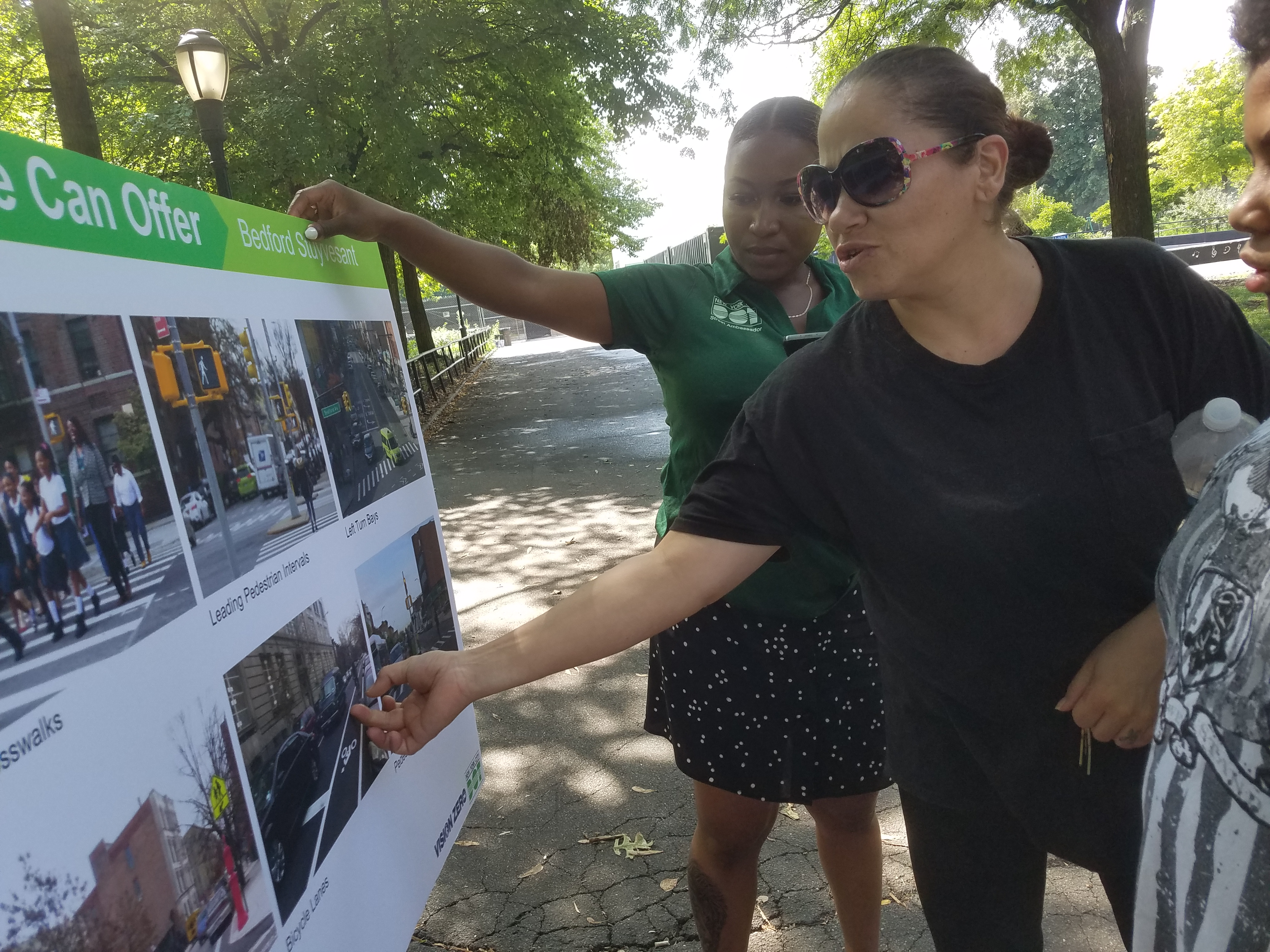 Bed Stuy residents and a Street Ambassador discuss potential street designs.