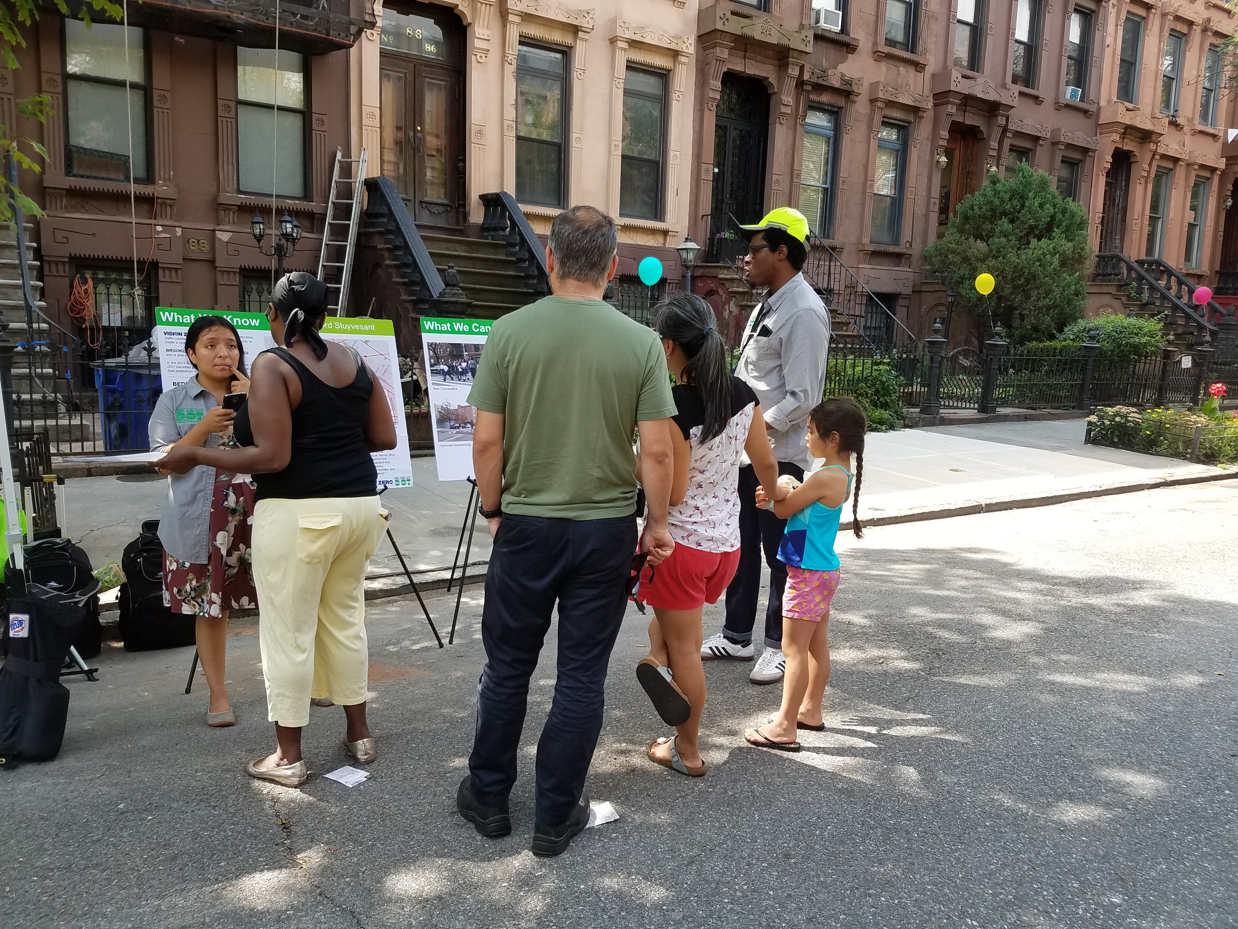 Street Ambassadors discuss transportation improvements with residents of Bed Stuy at the Hancock Block Party