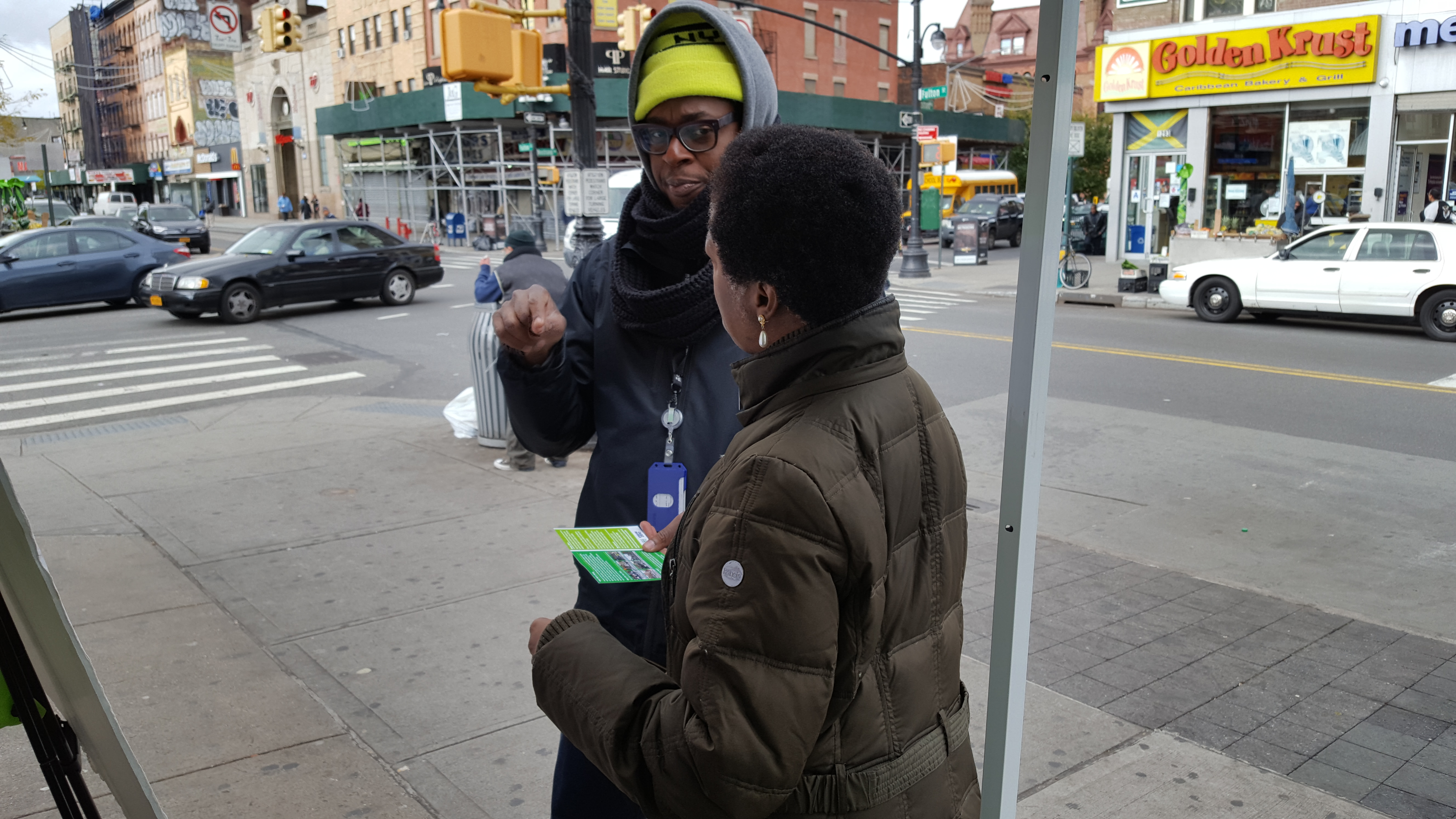 An Ambassador discusses traffic safety concerns in the neighborhood with a passerby