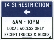 Busway signage explaining local access restrictions