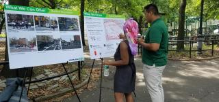 A Street Ambassador and Bed Stuy resident discuss transportation safety issues in Herbert Von King Park.