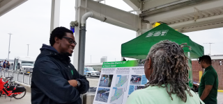 A Street Ambassador speaking with a member of the public at the St. George Ferry Terminal.