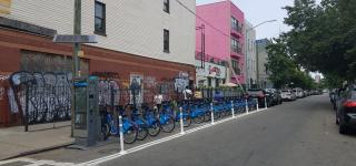 A Citi Bike station in Bushwick. It is located in the roadbed, where motor vehicle parking would normally be.