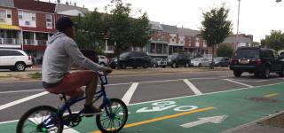 Cyclist on Two-Way Protected Bike Lane on 111th St, Queens