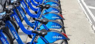 A row of Citi Bikes, docked in a station