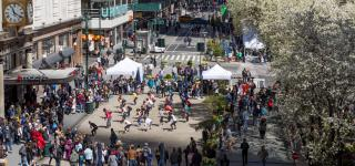 A birds eye view of people participating in a dance program at Herald Square